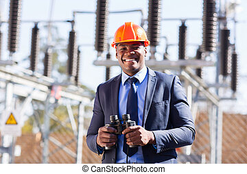 african industrial manager with binoculars