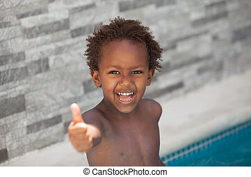 African little kid three years in the pool on summer