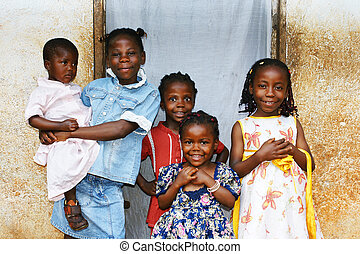 Real candid family photo of five cute and sweet black African sisters or girls, all smiling in their sunday dress, perfect for developing country and third world population issues.