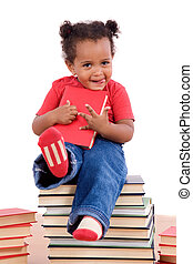 African little girl sitting on many books