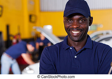 african male auto mechanic - close up portrait of happy...