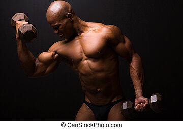 african male bodybuilder exercising