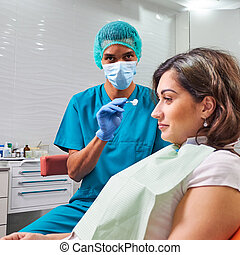African male dentist looking towards camera