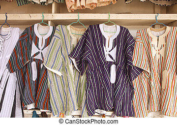 Assortment of men's tunics at a local market in Accra Ghana