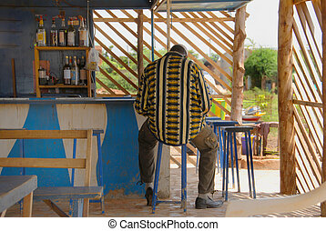 African man at the bar