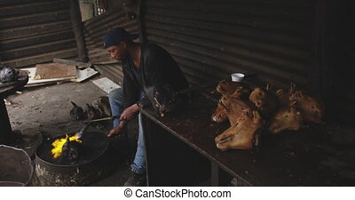 African man burning the meat