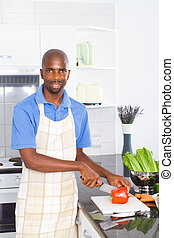 african man cooking