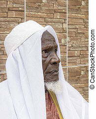 African man, eighty years old - African old man sitting in...