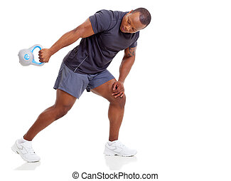 african man exercising with kettle bell