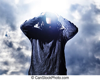 african man holding up dreds with dramatic light.