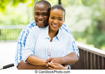 african man hugging girlfriend