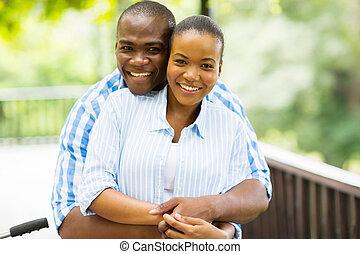 african man hugging girlfriend