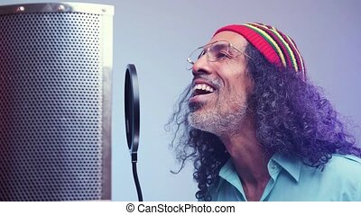 African man is singing in the studio - Attractive middle ...