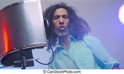 African man is singing in the studio - Handsome middle aged ...