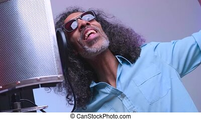 African man is singing in the studio - Middle aged american ...