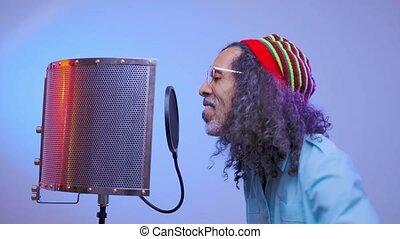 African man is singing in the studio - Talented singer in ...