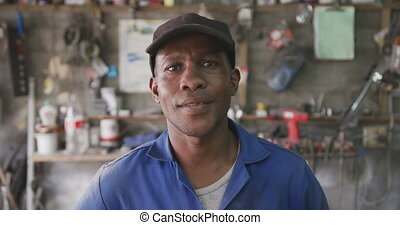 African man looking at the camera