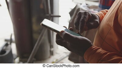 African man looking at touch pad at work - Side view mid ...