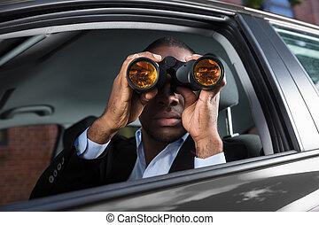 African Man Looking Through Binocular - Close-up Of An...