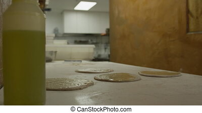African man making pizza dough - Side view mid section of an...