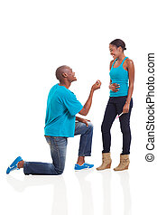 african man proposing to girlfriend when she is pregnant