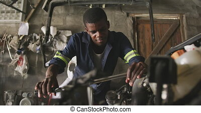 African man repairing car