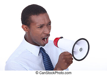 African man shouting through a megaphone