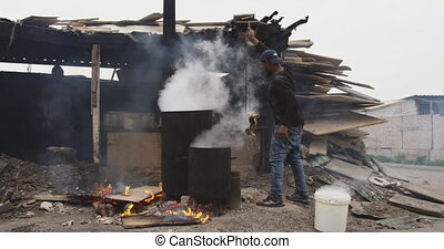 African man taking the meat with a stake