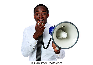 African man yelling through a megaphone isolated on a white...