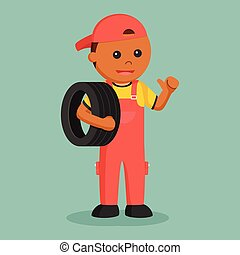 African mechanic carrying tire