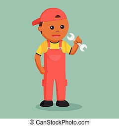 African mechanic holding wrench