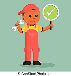 African mechanic with checklist sign indicate success
