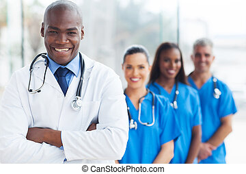 african medical doctor and colleagues in hospital