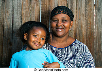 African mom with little girl.