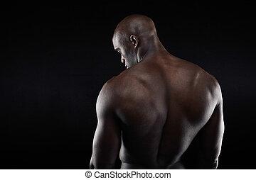 African muscular bodybuilder's back