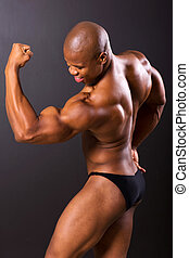 african muscular man showing muscles