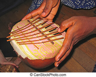 African musical instrument with the musician hands - Cameroon - Africa.