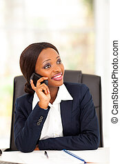 african office worker talking on cell