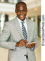 african office worker using mobile phone