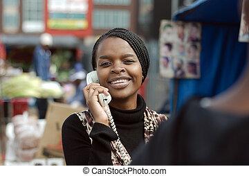 African or black American woman calling on landline ...