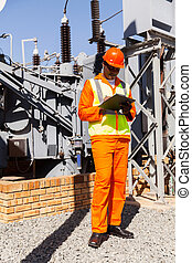 african power company technical worker writing on clipboard...