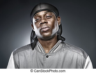 african rapper on grey background with bold lighting