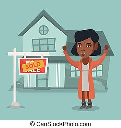 African real estate agent with sold placard.