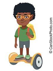 African schoolboy riding on gyroboard to school. - Joyful...