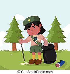 African scout girl keeping forest clean