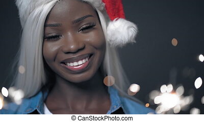 African sexy girl with white hair Happy christmas Sparkler...