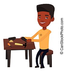 Shoemaker making handmade shoes in workshop. - African...