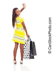african shopper waving goodbye