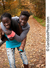 African sisters having fun - Happy foster children in the...
