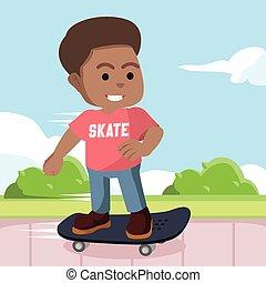 African skater boy in pedestrian
